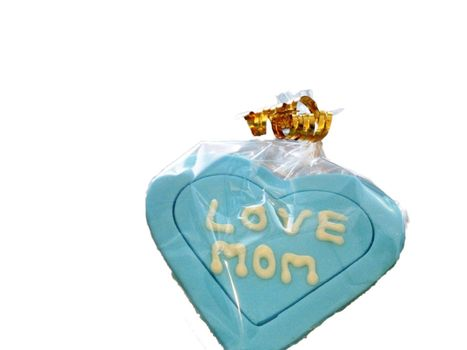 I love you Mom labeled gingerbread petal neatly wrapped in white background