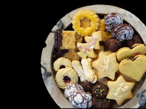 Christmas sweet biscuits in a variety of flavours with black background