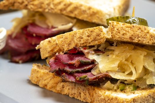 reuben sandwich on a plate with fries
