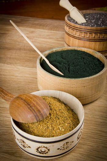 Various superfoods in wooden small dishes on the table