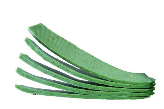 Gouda cheese with green pesto on white background