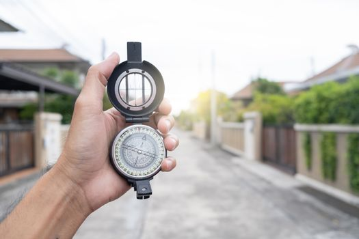 man holding compass on blurred background. for activity lifestyle outdoors freedom or travel tourism and inspiration backpacker alone tourist travel or navigator image.