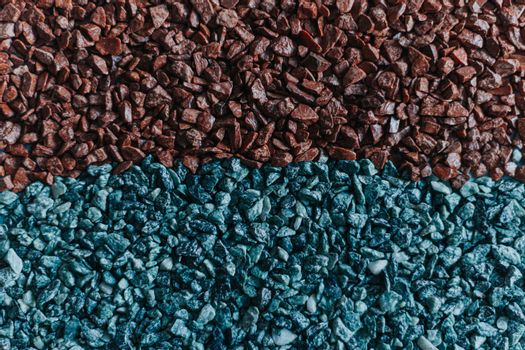 Flat background of blue and brown rocks split half and half