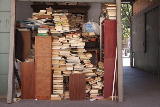 Rome, Italy - June 28, 2010: Stacks of old books at a street stall in the center of Rome.