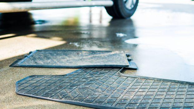 Dirty car rubber floor mat,close-up.