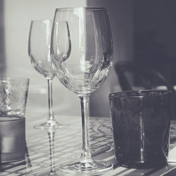 Crystal glasses on decorated glass table