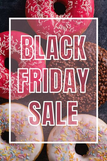 Black Friday sale banner on sweet donuts background
