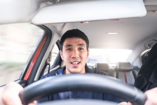 Young Asian man driving car He sometimes smile so happy drive To travel during the outbreak coronavirus covid-19
