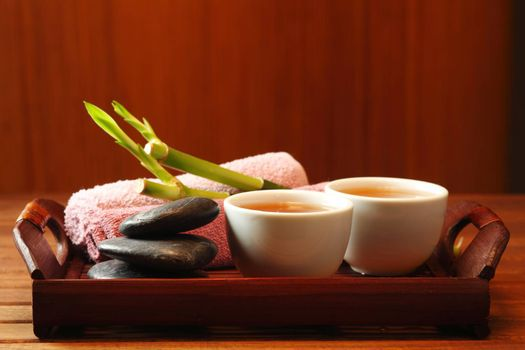 Still life with tea, stones and bamboo