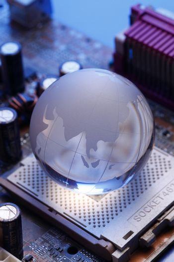 glass globe on the computer mother board