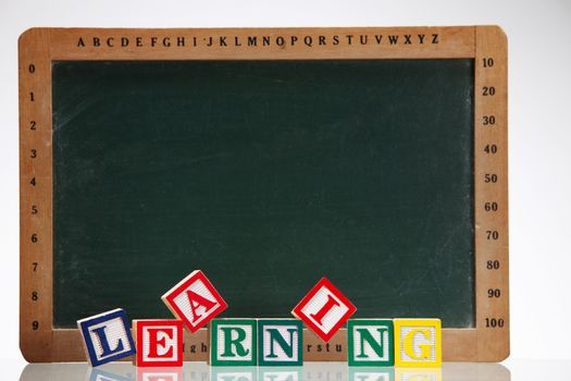 close up of the alphabet blocks in front of the black board