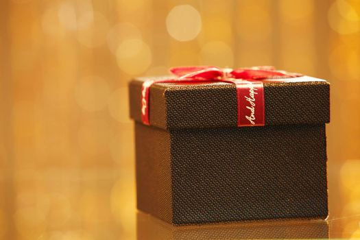 Wrapped gift with red ribbon