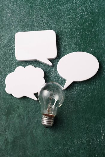 speech bubbles and the light bulb on the blackboard
