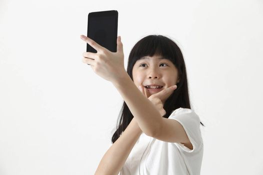 chinese girl self portrait with smart phone