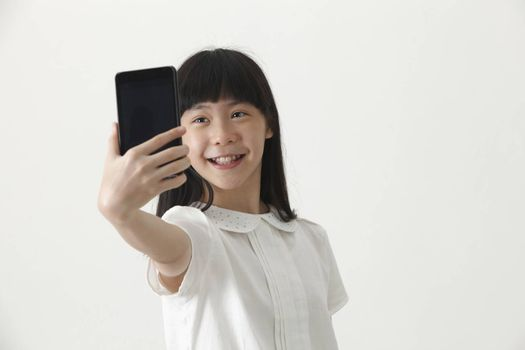 Front view chinese girl self portrait with smart phone