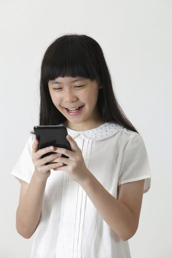 chinese girl happy reading sms