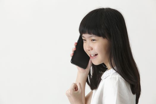 close up of the chinese girl talking with cellphone