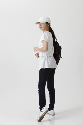 chinese girl in the walking position looking back