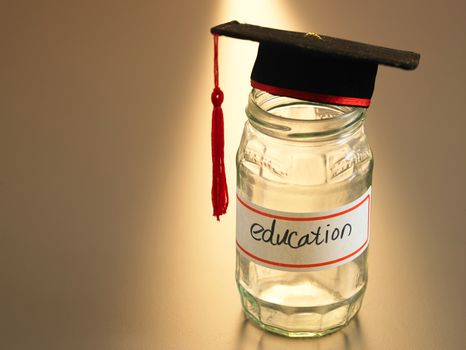 mortar board on the saving jar