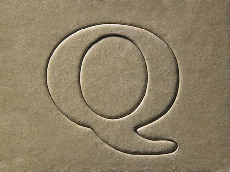 die cut alphabet q on the brown card board