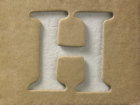 cut out alphabet h on the brown cardboard