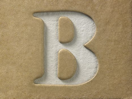 cut out alphabet b on the brown cardboard