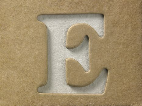 cut out alphabet e on the brown cardboard