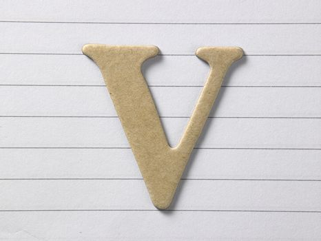 close up of alphabet v on single line book