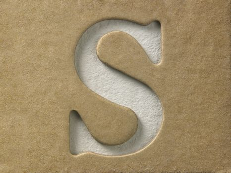 cut out alphabet s on the brown cardboard