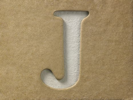 cut out alphabet j on the brown cardboard