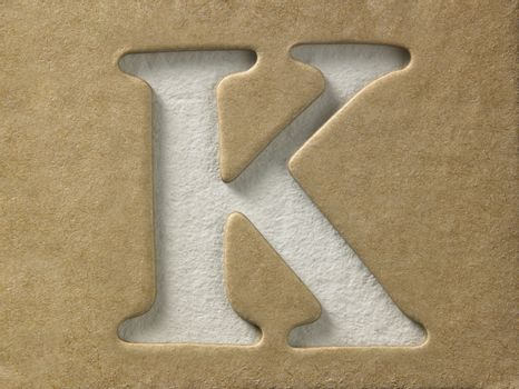 cut out alphabet k on the brown cardboard
