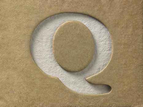 cut out alphabet q on the brown cardboard