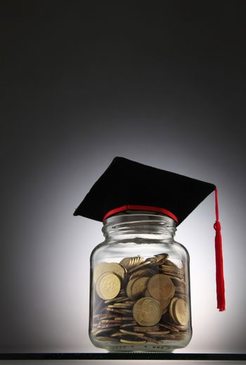 Bottle of cash with graduation cap.