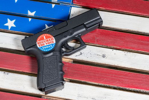 Concept of protecting against voter fraud with firearm and voting sticker