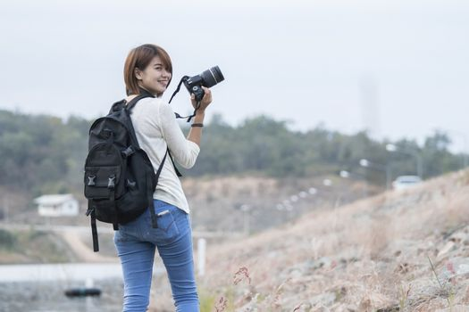 Asian woman with camera outdoor