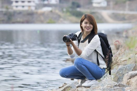 attractive young woman talking pictures outdoors,asian woman