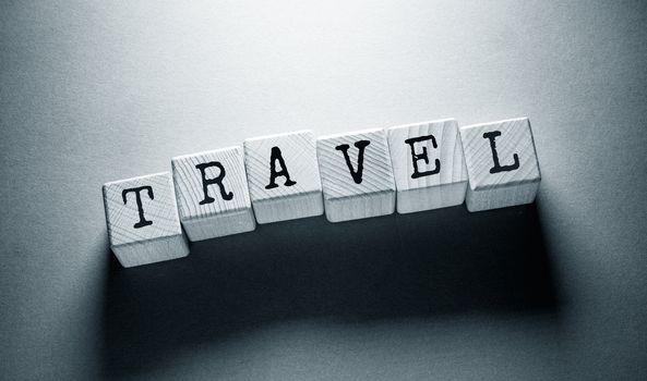 Travel Word Written on Wooden Cubes