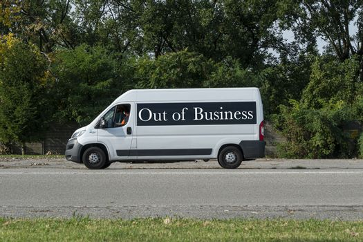 A commercial van with Out of Business written on the side