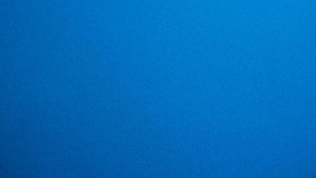 Blue-white matte suede background, close-up. Velvety texture