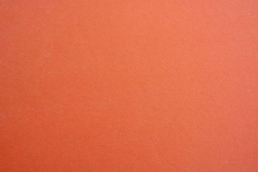 The canvas is orange. The fabric is rough orange. Background texture