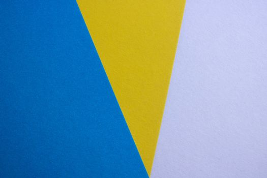 blue-yellow matte suede background, close-up. Velvety texture