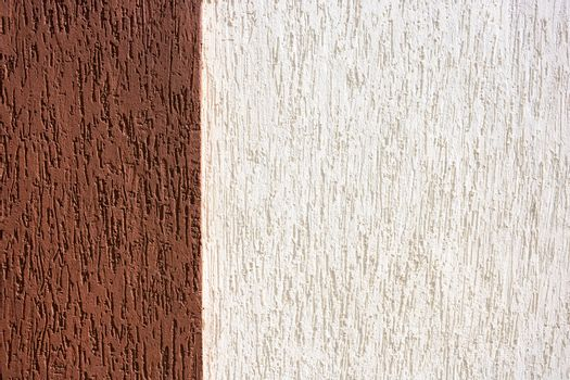 Decorative plaster background in two colors brown and white.