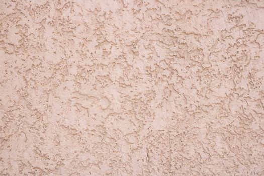 Pink decorative relief . Pink stucco wall. Pink background of the wall