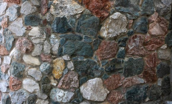 The wall is made of colored stones.Design style wall decor