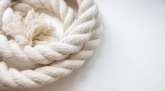 White thick rope isolated on a white background.Space for your text