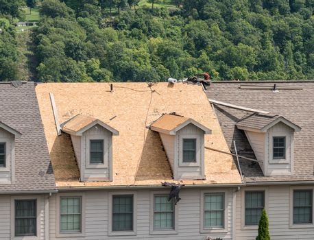 Townhouse roof after removal of the old shingles ready for reroofing