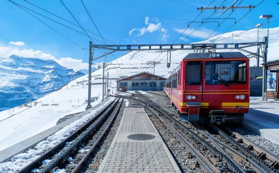 A red swiss train in Station, Switzerland