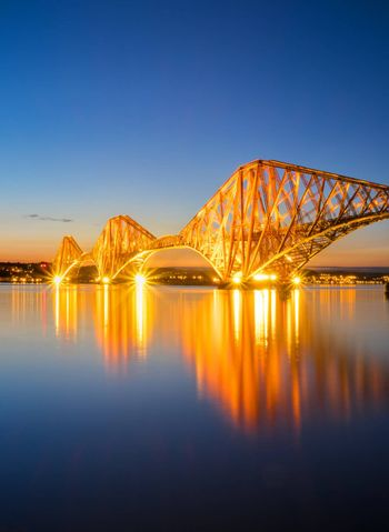 The red Forth Railbridge in Scotland at night