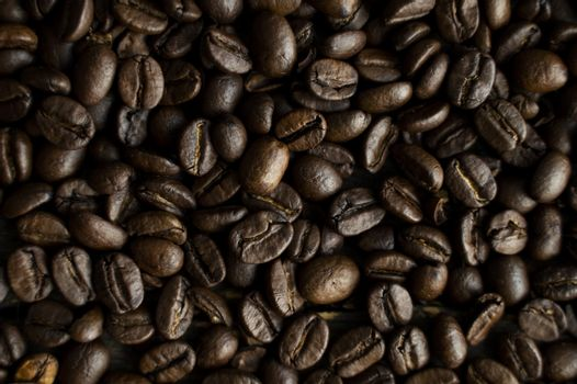 Fresh arabica coffee beans as a texture or background.