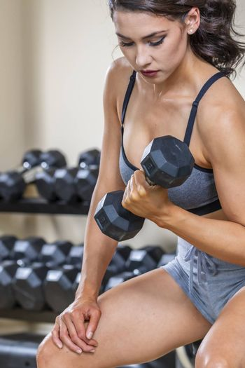 A brunette fitness model preparing to work out